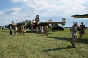 B-25 with a large contingent of people dressed in period uniforms